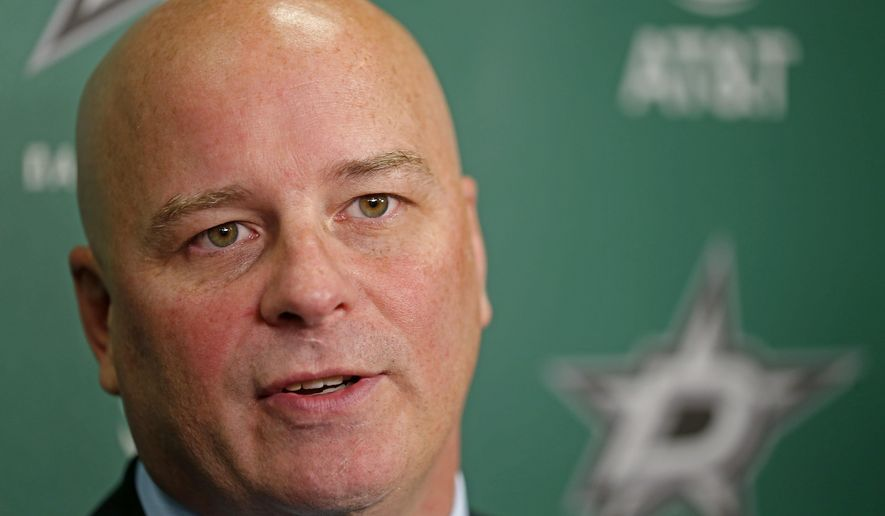 Dallas Stars new head coach Jim Montgomery speaks at an NHL hockey press conference at American Airlines Center in Dallas, Friday, May 4, 2018. Montgomery, the second head coach in three years to go from the college ranks to the NHL, was 125-57-26 the past five seasons at the University of Denver, including a national title in 2016-17. (Jae S. Lee/The Dallas Morning News via AP)