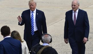 President Donald Trump and White House Chief of Staff John Kelly walk on the tarmac at Andrews Air Force Base before boarding Air Force One, Friday, May 4, 2018. Trump is traveling to Dallas where he will address the NRA convention. (AP Photo/Susan Walsh)