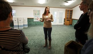 In this April 30, 2018, photo, Jena Jones, Director of the Short Creek Dream Center, guides a tour through the renovated facility, formally the home of polygamous sect leader Warren Jeffs in Hildale, Utah. The sprawling house surrounded by towering brick walls has been converted into a sober living center by Evangelical missionaries, the latest sign of the group's dwindling control of the small community on the Utah-Arizona border. (Chris Caldwell/The Spectrum via AP)