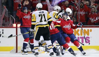 Washington Capitals center Lars Eller, left, from Denmark, and Washington Capitals left wing Jakub Vrana, right, from the Czech Republic, celebrate a goal by right wing Brett Connolly during the first period of Game 5 in the second round of the NHL Stanley Cup hockey playoffs against the Pittsburgh Penguins, Saturday, May 5, 2018, in Washington. (AP Photo/Alex Brandon)