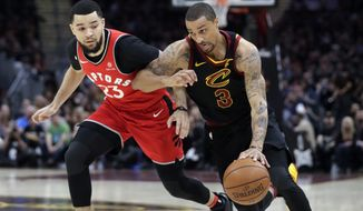 Cleveland Cavaliers' George Hill (3) drives on Toronto Raptors' Fred VanVleet (23) during the first half of Game 3 of an NBA basketball second-round playoff series Saturday, May 5, 2018, in Cleveland. (AP Photo/Tony Dejak) ** FILE **