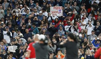 Fans applaud after Los Angeles Angels' Albert Pujols singled for his 3,000th career hit, against the Seattle Mariners during the fifth inning of a baseball game Friday, May 4, 2018, in Seattle. (AP Photo/Jason Redmond)
