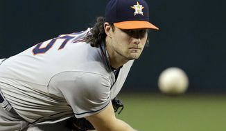 Houston Astros pitcher Gerrit Cole throws in the first inning of a baseball game against the Arizona Diamondbacks, Friday, May 4, 2018, in Phoenix. (AP Photo/Rick Scuteri)