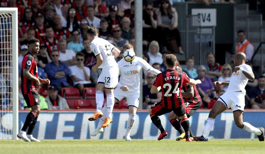 AFC Bournemouth's Ryan Fraser, second from right, scores his side's first goal of the game against Swansea, during the English Premier League soccer match at the Vitality Stadium in Bournemouth, England, Saturday May 5, 2018. (Andrew Matthews/PA via AP)