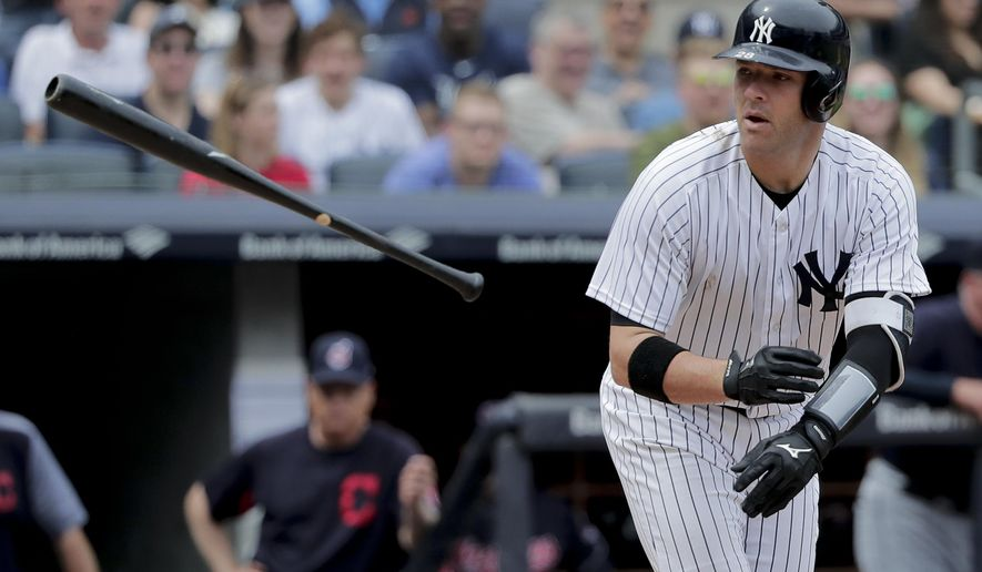 New York Yankees' Austin Romine tosses his bat after walking with the bases loaded to score Neil Walker during the fifth inning of a baseball game against the Cleveland Indians, Saturday, May 5, 2018, in New York. (AP Photo/Julie Jacobson)