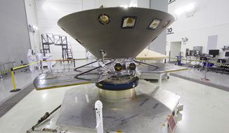 NASA's Mars bound InSight lander undergoes its final check outs and processing before encapsulation and mating to a ULA Atlas V rocket. The 6 month mission to Mars is the first inter-plantary launch from the west coast and the first Mars bound mission from California. NASA's Jet Propulsion Laboratory is leading the mission to Mars to collect, analyze and discover the red plants beginnings and to study its interior. (Matt Hartman for AP)