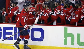 Washington Capitals defenseman John Carlson (74) celebrates his goal during the first period of Game 5 in the second round of the NHL Stanley Cup hockey playoffs against the Pittsburgh Penguins, Saturday, May 5, 2018, in Washington. (AP Photo/Alex Brandon) ** FILE **