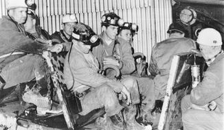In this Nov. 24, 1968, file photo, one of two seven-man rescue teams enters the Consolidation Coal mines in Farmington, W.Va., where 78 miners have been trapped. It's been nearly half a century since 78 men perished in the Farmington No. 9 mine disaster in West Virginia, but to those who lost loved ones, the questions have never been answered.  This week, families of the lost miners will ask a federal appeals court to reinstate a lawsuit they filed in 2014. (AP Photo/File)
