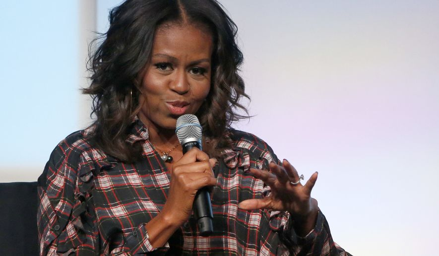 Former first lady Michelle Obama address the crowd during a conversation with poet Elizabeth Alexander at the second day of the Obama Foundation Summit, Wednesday, Nov. 1, 2017, in Chicago. (AP Photo/Charles Rex Arbogast)