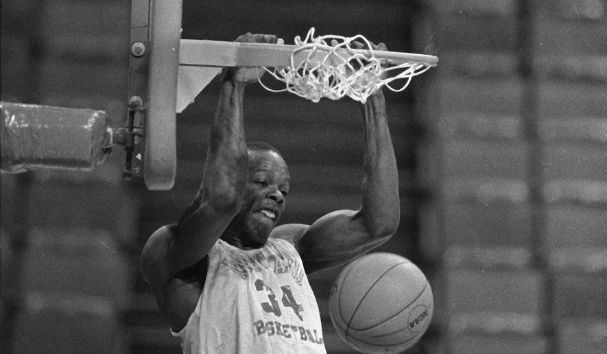 University of Maryland's Len Bias slams home a dunk at the Omni in Atlanta, Ga., March 7, 1985 as the Terrapins prepare for the Atlantic Coast Conference Tournament game against Duke.  (AP Photo/Bob Jordan)