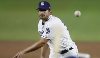 San Diego Padres pitcher Brad Hand throws to a Los Angeles Dodgers batter during the eighth inning of a baseball game Saturday, May 5, 2018, in Monterrey, Mexico. The Padres won 7-4. (AP Photo/Eduardo Verdugo)