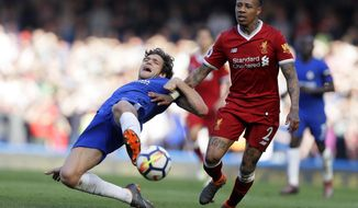 Chelsea's Marcos Alonso, left, challenges for the ball with Liverpool's Nathaniel Clyne during the English Premier League soccer match between Chelsea and Liverpool at Stamford Bridge stadium in London, Sunday, May 6, 2018. (AP Photo/Kirsty Wigglesworth)