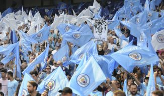 Manchester City fans cheer prior to the English Premier League soccer match between Manchester City and Huddersfield Town at Etihad stadium in Manchester, England, Sunday, May 6, 2018. (AP Photo/Rui Vieira)