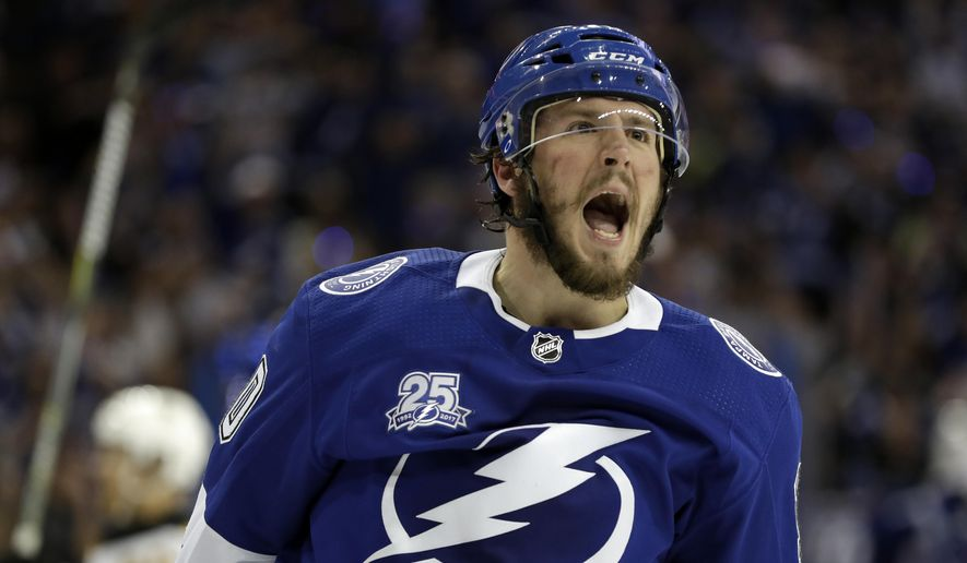Tampa Bay Lightning center J.T. Miller celebrates after scoring against the Boston Bruins during the second period of Game 5 of an NHL second-round hockey playoff series Sunday, May 6, 2018, in Tampa, Fla. (AP Photo/Chris O'Meara)