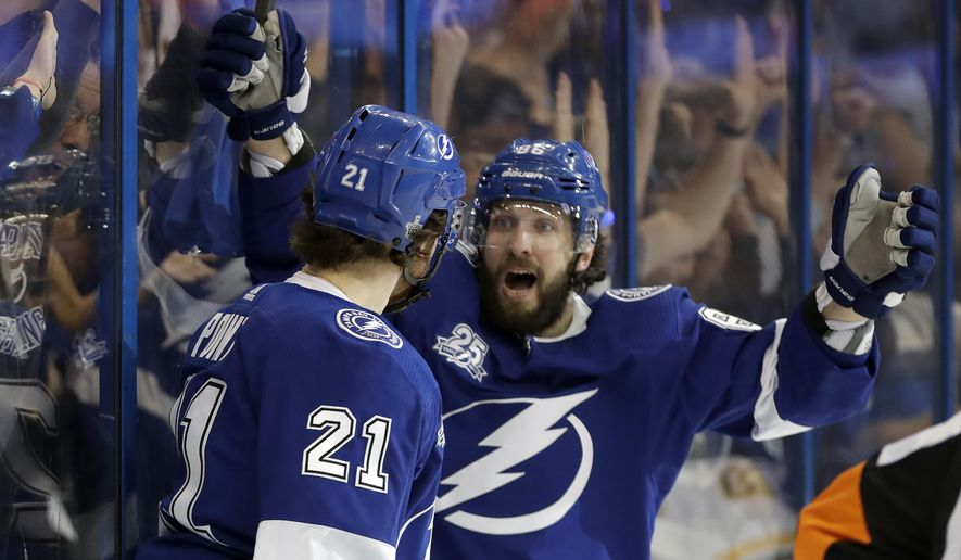 Tampa Bay Lightning center Brayden Point (21) celebrates with Nikita Kucherov after Point scored against the Boston Bruins during the second period of Game 5 of an NHL second-round hockey playoff series Sunday, May 6, 2018, in Tampa, Fla. (AP Photo/Chris O'Meara)
