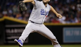 FILE - In this May 1, 2018, file photo, Los Angeles Dodgers starting pitcher Clayton Kershaw throws against the Arizona Diamondbacks during the first inning of a baseball game in Phoenix. Dodgers ace Clayton Kershaw was put on the 10-day disabled list with left biceps tendinitis. A three-time NL Cy Young Award winner, Kershaw is on the disabled list for the fourth time. (AP Photo/Matt York, File)