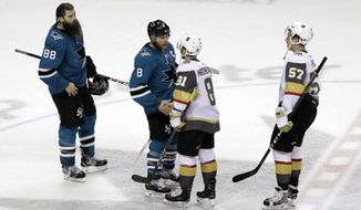 San Jose Sharks center Joe Pavelski (8) shakes hands with Vegas Golden Knights center Jonathan Marchessault (81) at the end of Game 6 of an NHL hockey second-round playoff series Sunday, May 6, 2018, in San Jose, Calif. Vegas won 3-0. (AP Photo/Marcio Jose Sanchez)