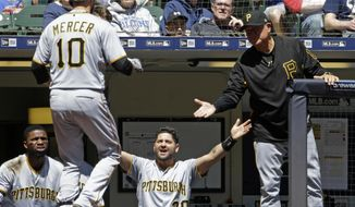 Pittsburgh Pirates' Jordy Mercer (10) is congratulated by Francisco Cervelli (29) and manager Clint Hurdle during the second inning of a baseball game against the Milwaukee Brewers, Sunday, May 6, 2018, in Milwaukee. (AP Photo/Aaron Gash)