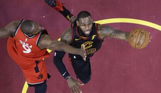 Cleveland Cavaliers' LeBron James shoots against Toronto Raptors' Serge Ibaka (9) during the first half of Game 3 of an NBA basketball second-round playoff series Saturday, May 5, 2018, in Cleveland. (AP Photo/Tony Dejak)