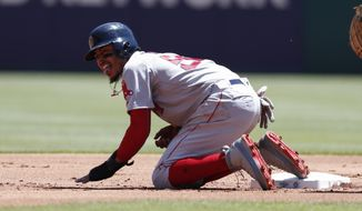Boston Red Sox's Mookie Betts (50) reacts after sliding hard to second base on a ground out by Andrew Benintendi during the first inning of a baseball game, Sunday, May 6, 2018, in Arlington, Texas. (AP Photo/Jim Cowsert)