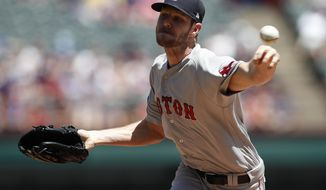 Boston Red Sox starting pitcher Chris Sale delivers to the Texas Rangers during the first inning of a baseball game, Sunday, May 6, 2018, in Arlington, Texas. (AP Photo/Jim Cowsert)