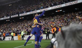 Barcelona's Lionel Messi clenches his fist as he celebrates scoring his side's second goal during a Spanish La Liga soccer match between Barcelona and Real Madrid, dubbed 'El Clasico', at the Camp Nou stadium in Barcelona, Spain, Sunday, May 6, 2018. (AP Photo/Emilio Morenatti)
