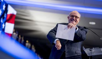 Rudy Giuliani, an attorney for President Donald Trump, pretends to tear a piece of paper as he speaks about the Iran nuclear agreement while speaking at the Iran Freedom Convention for Human Rights and democracy at the Grand Hyatt, Saturday, May 5, 2018, in Washington. (AP Photo/Andrew Harnik)