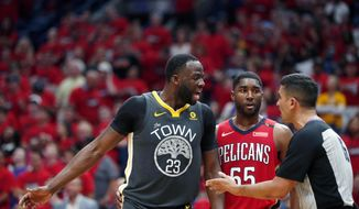 Golden State Warriors forward Draymond Green (23) challenges an official in front of New Orleans Pelicans forward E'Twaun Moore (55) in the first half of Game 4 of a second-round NBA basketball playoff series in New Orleans, Sunday, May 6, 2018. (AP Photo/Gerald Herbert)