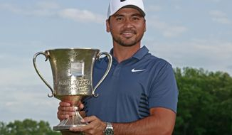 Jason Day poses with the trophy after winning the Wells Fargo Championship golf tournament at Quail Hollow Club in Charlotte, N.C., Sunday, May 6, 2018. (AP Photo/Jason E. Miczek)