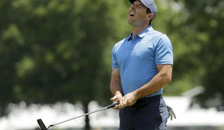 Rory McIlroy, of Northern Ireland, reacts to missing a putt on the second hole during the final round of the Wells Fargo Championship golf tournament at Quail Hollow Club in Charlotte, N.C., Sunday, May 6, 2018. (AP Photo/Chuck Burton)