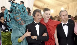 Frances McDormand, from left, Pierpaolo Piccioli, Anne Hathaway and Adam Shulman attend The Metropolitan Museum of Art's Costume Institute benefit gala celebrating the opening of the Heavenly Bodies: Fashion and the Catholic Imagination exhibition on Monday, May 7, 2018, in New York. (Photo by Evan Agostini/Invision/AP)