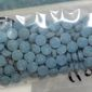 This undated photo made available by the U.S. Drug Enforcement Administration shows heroin fentanyl pills. (DEA via AP)