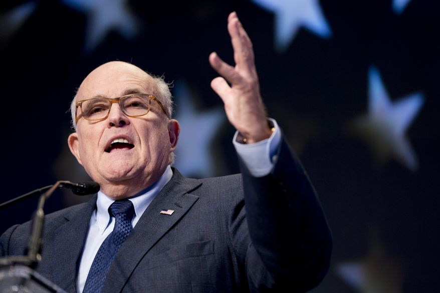 Rudy Giuliani, an attorney for President Donald Trump, speaks at the Iran Freedom Convention for Human Rights and democracy at the Grand Hyatt, Saturday, May 5, 2018, in Washington. (AP Photo/Andrew Harnik) ** FILE **