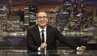"""This image released by HBO shows John Oliver, host of """"Last Week Tonight with John Oliver."""" Oliver said Sunday that he'd achieved all he'd wanted for the show by having an Australian animal hospital's special ward to treat a chlamydia outbreak among koalas named for him. He said, """"goodbye, forever, everyone,"""" as stagehands broke up his set around him. That inspired a wave of social media posts among fans wondering if he was serious. (Eric Liebowitz/HBO via AP)"""