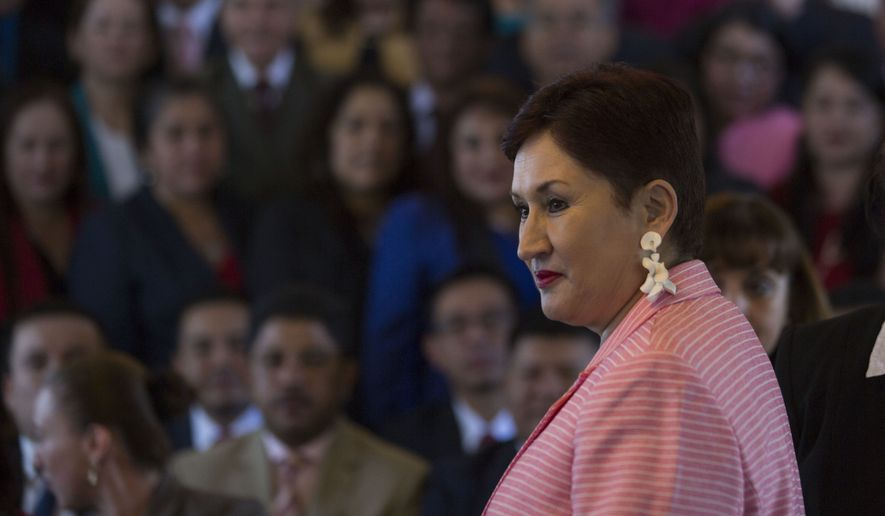 In this April 19, 2018, file photo, Guatemala's General Attorney Thelma Aldana, who sent a president to prison and broke up a number of high-level corruption rings, stands moments before a group photo with prosecutors in Guatemala City. The biggest trophy on her wall from four years in office: Taking down a network allegedly led by then-President Otto Perez Molina, who is accused of defrauding the state of millions of dollars. (AP Photo/Moises Castillo)