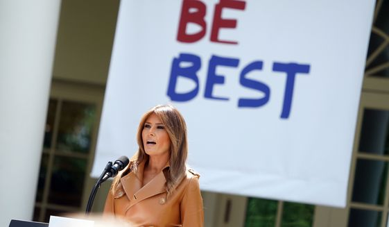 """First lady Melania Trump speaks on her initiatives during an event in the Rose Garden of the White House, Monday, May 7, 2018, in Washington.  The first lady gave her multipronged effort to promote the well-being of children a minimalist new motto: """"BE BEST.""""  The first lady formally launched her long-awaited initiative after more than a year of reading to children, learning about babies born addicted to drugs and hosting a White House conversation on cyberbullying.   (AP Photo/Andrew Harnik)"""