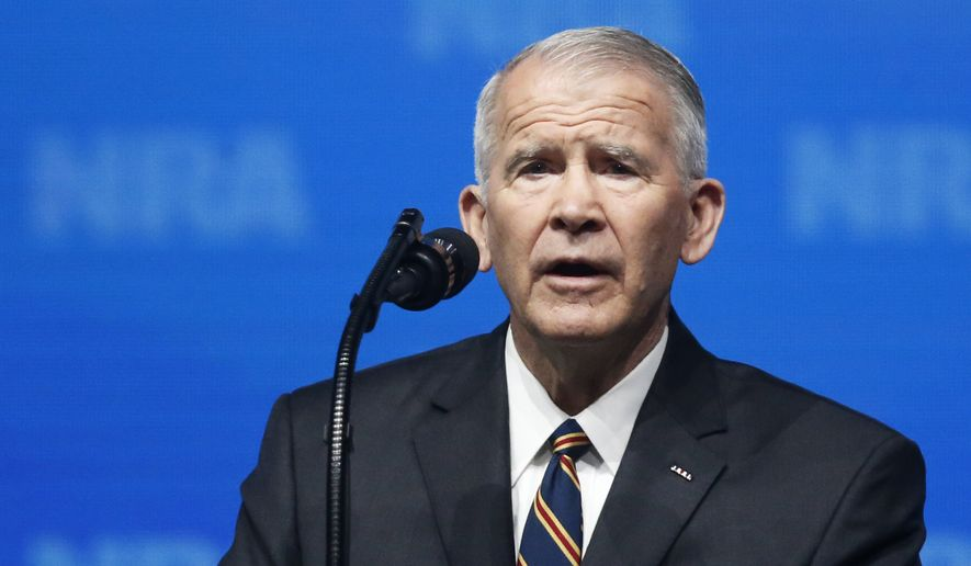 In this May 4, 2018, photo, former U.S. Marine Lt. Col. Oliver North speaks before giving the Invocation at the National Rifle Association-Institute for Legislative Action Leadership Forum in Dallas. (AP Photo/Sue Ogrocki) ** FILE **