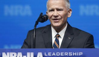 Former U.S. Marine Lt. Col. Oliver North speaks before giving the Invocation at the National Rifle Association-Institute for Legislative Action Leadership Forum in Dallas. The NRA announced today that North will become President of the National Rifle Association of America within a few weeks, a process the NRA Board of Directors initiated this morning. (AP Photo/Sue Ogrocki)