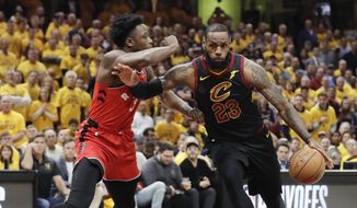 Cleveland Cavaliers' LeBron James (23) drives on Toronto Raptors' OG Anunoby (3), from England, in the first half of Game 4 of an NBA basketball second-round playoff series, Monday, May 7, 2018, in Cleveland. (AP Photo/Tony Dejak) **FILE**