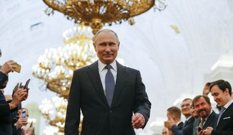 Vladimir Putin enters to take the oath during his inauguration ceremony for a new term as Russia's president in the Grand Kremlin Palace in Moscow, Russia, Monday, May 7, 2018. Putin took the oath of office for his fourth term as Russian president on Monday and promised to pursue an economic agenda that would boost living standards across the country. (AP Photo/Alexander Zemlianichenko, Pool)