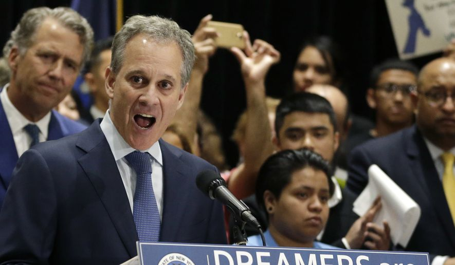 In this Sept. 6, 2017, file photo, New York Attorney General Eric Schneiderman, at podium, speaks at a news conference in New York, surrounded by beneficiaries of the Deferred Action for Childhood Arrivals program and their supporters. Schneiderman, who had taken on high-profile roles as an advocate for women's issues and an antagonist to the policies of President Donald Trump, announced late Monday, May 7, 2018, that he would be resigning from office hours after four women he was romantically involved with accused him of physical violence in accounts published by The New Yorker. (AP Photo/Seth Wenig, File) **FILE**