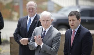 Attorney General Jeff Sessions looks on during a news conference near the border with Tijuana, Mexico, Monday, May 7, 2018, in San Diego. Sessions discussed immigration enforcement during his Southern California visit Monday. (AP Photo/Gregory Bull) ** FILE **