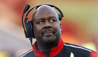 FILE - In this Nov. 21, 2015, file photo, then-Maryland interim head coach Mike Locksley watches from the sideline during an NCAA college football game against Indiana, in College Park, Md. New Alabama offensive coordinator Mike Locksley will make $1.2 million annually and defensive coordinator Tosh Lupoi is set to earn $1.1 million. Trustees approved deals for 10 Crimson Tide assistants Monday, May 7, 2018 with only offensive line coach Brent Key remaining in the same job. Both coordinators have three-year deals. (AP Photo/Patrick Semansky) ** FILE **