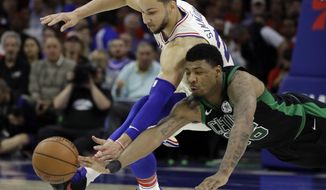 Boston Celtics' Marcus Smart, right, and Philadelphia 76ers' Ben Simmons chase after a loose ball during the first half of Game 3 of an NBA basketball second-round playoff series, Monday, May 7, 2018, in Philadelphia. (AP Photo/Matt Slocum)