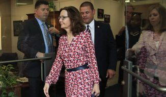 CIA Director nominee Gina Haspel leaves the office of Sen. Dianne Feinstein, D-Calif., following a meeting on Capitol Hill in Washington, Monday, May 7, 2018. (AP Photo/Manuel Balce Ceneta)