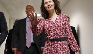 CIA Director nominee Gina Haspel, waves as she arrives for her meeting with Sen. Joe Manchin, D-W.Va., on Capitol Hill in Washington, Monday, May 7, 2018. Walking with her is White House legislative affairs director Marc Short, left. (AP Photo/Pablo Martinez Monsivais)