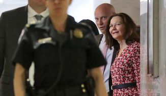 CIA Director nominee Gina Haspel, right, arrives for her meeting with Sen. Joe Manchin, D-W.Va., on Capitol Hill in Washington, Monday, May 7, 2018. Walking with her is White House legislative affairs director Marc Short. (AP Photo/Pablo Martinez Monsivais)