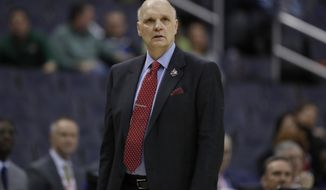 "This March 9, 2018 photo shows Saint Joseph's head coach Phil Martelli watching his team during the second half of an NCAA college basketball quarterfinal game against George Mason in the Atlantic 10 Conference tournament in Washington. Martelli said Monday, May 7, 2018 that everyone involved in college basketball needs to help ""create a new model"" following recent reform proposals amid a federal corruption investigation into the sport. (AP Photo/Alex Brandon)"