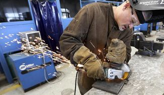 In this photo taken May 2, 2018, Roberto Rotgers, of Egg Harbor Township, N.J., uses a grinder to smooth out a weld during a certification test at Cape May County Technical High School in Cape May Court House, N.J. Rotgers spent 26 years working in the casino industry in Atlantic City and found the welding class through employment services. (Dale Gerhard/The Press of Atlantic City via AP)