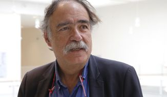 """Portuguese film producer Paulo Branco arrives at Paris' court house, Monday, May 7, 2018. This year's Cannes Film Festival is kicking off with a legal dispute, as a Paris court weighs whether the festival can legally show Monty Python star Terry Gilliam's long-awaited film """"The Man Who Killed Don Quixote"""" or not. Portuguese producer Paulo Branco, who initially worked with Gilliam on the film, claims he has the rights to the movie and sued Cannes organizers to stop them from showing it. Gilliam, 77, contests Branco's claims. (AP Photo/Michel Euler)"""
